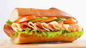Sandwich. Big sandwich with on wooden board royalty free stock images
