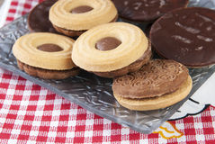 Sandwich biscuits on the wooden table. Close up photo Stock Photo