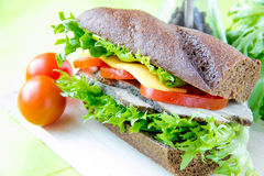 Sandwich with beef, cheese and vegetables Stock Photo