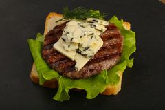 Sandwich with blue cheese and burger cutlet Stock Photo