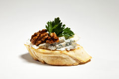 Sandwich with blue cheese, walnut and parsley on grey background. Sandwich with blue cheese, walnut and parsley on the grey background Stock Images