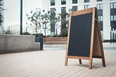 Sandwich Board at the street near skyscarpers. royalty free stock photography