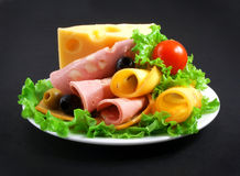 Sandwich with boiled sausage, greens and cheese on a white plate Royalty Free Stock Photos
