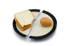 Sandwich bread and egg on a broken plate for diet concept. Royalty Free Stock Photography