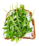 Sandwich from bread, spread and fresh arugula Royalty Free Stock Photography