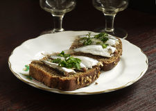 Sandwich with brown bread and anchovies Stock Photos