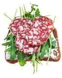 Sandwich from brown bread, salami and green salad Royalty Free Stock Photography