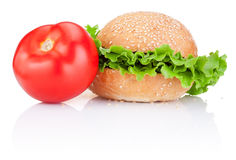 Sandwich bun with lettuce and red tomato  Stock Photos