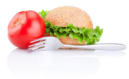 Sandwich bun with lettuce, tomato and fork isolated Royalty Free Stock Photography