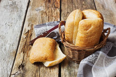 Sandwich bun. With seasoning in a basket on an old wooden table. simple rustic food Royalty Free Stock Image