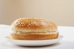 Sandwich bun with sesame seeds Stock Photo