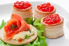 Sandwich and canapes with caviar and fish Royalty Free Stock Photos