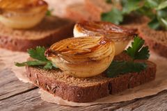 Sandwich with caramelized onions and parsley closeup horizontal Stock Photos