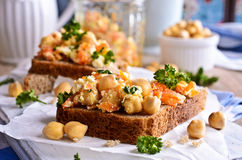 Sandwich with carrots, cheese and chickpeas Stock Photos