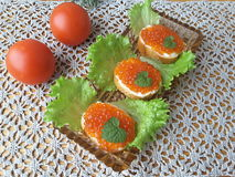 Sandwich with caviar, on a plate with lettuce. Healthy food royalty free stock images