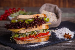 Sandwich with cereals bread with lettuce,ham, prosciutto Stock Photos