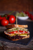 Sandwich with cereals bread with lettuce,ham, prosciutto Royalty Free Stock Image