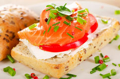 Sandwich with cereals bread and salmon on a white plate. Stock Photo