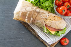 Sandwich with cheese abd ham, salad and tomatoes Royalty Free Stock Images