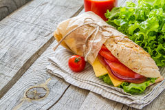 Sandwich with cheese abd ham, salad and tomatoes Royalty Free Stock Photography
