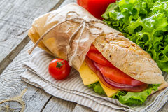 Sandwich with cheese abd ham, salad and tomatoes Royalty Free Stock Image