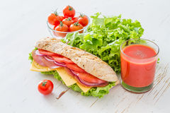 Sandwich with cheese abd ham, salad and tomatoes Stock Image