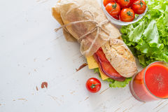 Sandwich with cheese abd ham, salad and tomatoes Stock Images