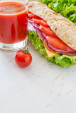 Sandwich with cheese abd ham, salad and tomatoes Royalty Free Stock Photos