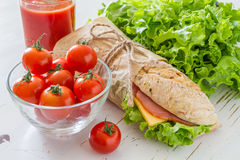 Sandwich with cheese abd ham, salad and tomatoes Stock Photo