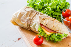 Sandwich with cheese abd ham, salad and tomatoes Stock Photography