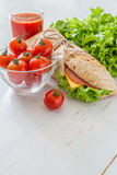 Sandwich with cheese abd ham, salad and tomatoes Royalty Free Stock Photo
