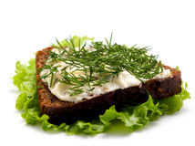 Sandwich with cheese and aromatic herbs. Royalty Free Stock Images