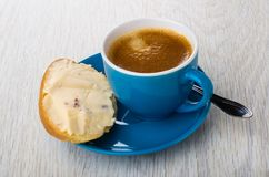 Sandwich with cheese, coffee in cup, spoon on saucer on table stock photography