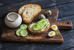 Sandwich with cheese and cucumber and boiled quail eggs - healthy delicious breakfast or snack. Stock Image