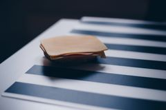 Sandwich with cheese and ham. Sandwich with cheese and ham on the black & white table Royalty Free Stock Photography