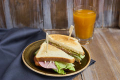 Sandwich with cheese, ham and lettuce Royalty Free Stock Image