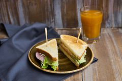 Sandwich with cheese, ham and lettuce Royalty Free Stock Photography
