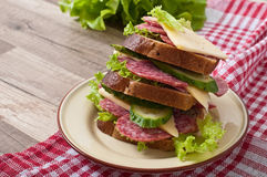 Sandwich with cheese and meat sausages Royalty Free Stock Images