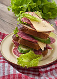Sandwich with cheese and meat sausages Royalty Free Stock Photos