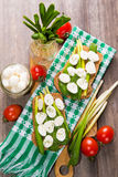 Sandwich with cheese. Sandwich with mozzarella,ramson and tomatoes in studio Stock Photo