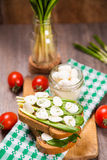 Sandwich with cheese. Sandwich with mozzarella,ramson and tomatoes in studio Royalty Free Stock Images
