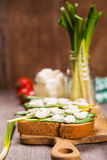 Sandwich with cheese. Sandwich with mozzarella,ramson and tomatoes in studio Stock Photos
