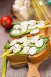 Sandwich with cheese. Sandwich with mozzarella,ramson and tomatoes in studio Royalty Free Stock Image