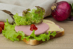 Sandwich with cheese and sausages Stock Photo