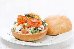Sandwich with cheese, tomato and salmon on the plate Royalty Free Stock Photo