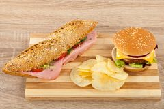 Sandwich, cheeseburger and chips royalty free stock photography