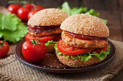 Sandwich with chicken burger. Tomatoes and lettuce Royalty Free Stock Image