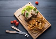 Sandwich with chicken and salad and potato chips on wooden background royalty free stock photo