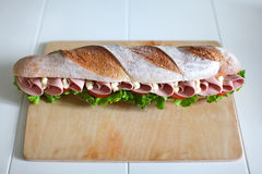 Sandwich with chicken salami, tomatoes, salad and mayonnaise Royalty Free Stock Photography