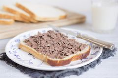 Sandwich with chocolate sprinkles, Dutch traditional food. A sandwich with chocolate sprinkles or `vlokken`, Dutch traditional food royalty free stock photography